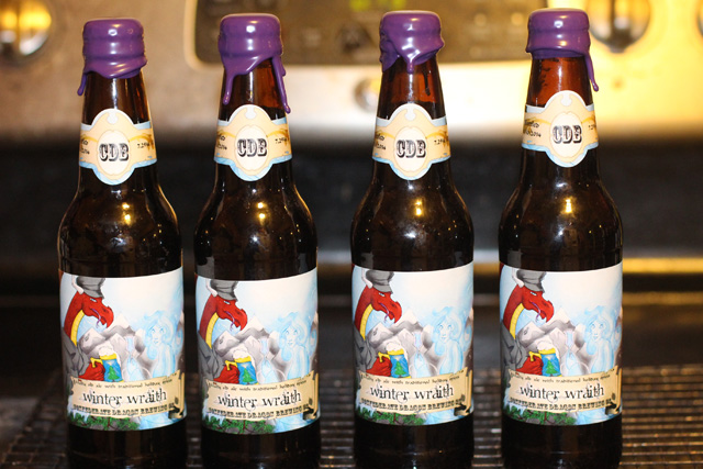 Holiday beer bottles, labeled and waxed